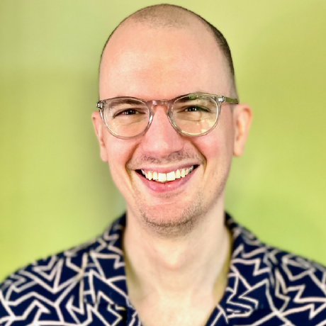 A smiling Memoji with a mustache and glasses